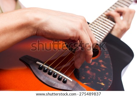 musician play sunburst color acoustic guitar , focus to right hand fingertip / isolated on white - stock photo