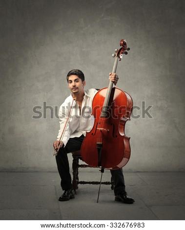 Musician playing a violoncello - stock photo