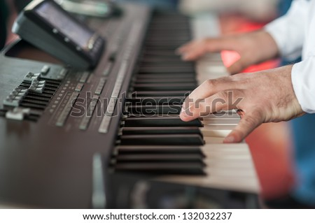 Musician playing on keyboards.Hands playing - stock photo