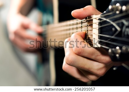 musician playing on the acoustic guitar - stock photo