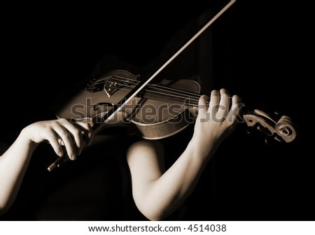 musician playing violin, sepia effect - stock photo