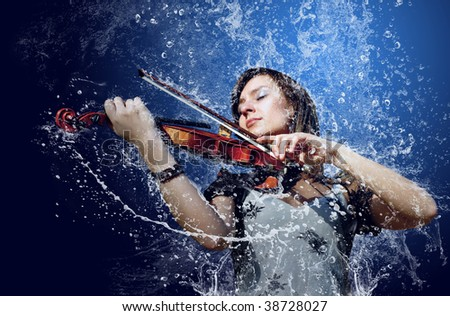 Musician playing violin under water - stock photo