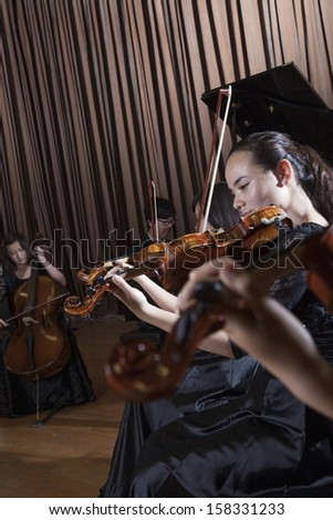 Musicians playing during a performance - stock photo
