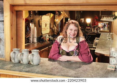 MUSKOGEE, OK - MAY 24: A woman dressed in historic clothing enjoys bartending at the Oklahoma 19th annual Renaissance Festival on May 24, 2014 at the Castle of Muskogee in Muskogee, OK.  - stock photo