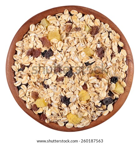 Musli in a wooden bowl on a white background - stock photo