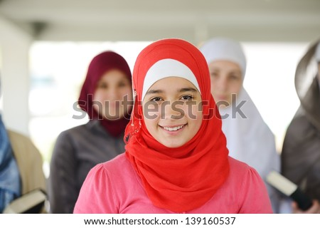 Muslim and Arabic girls standing together in line row - stock photo