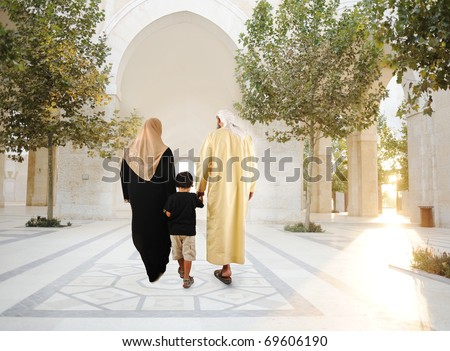 Muslim arabic traditional oriental family walking together, beautiful ambient in front of the mosque - stock photo