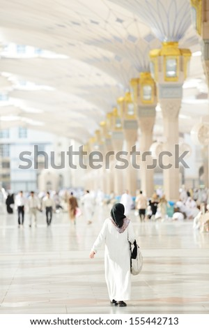 Muslim Arabic woman portrait outdoors in holy mosque - stock photo