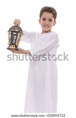 Muslim Boy In White Djellaba with Lantern Celebrating Ramadan Isolated on White Background - stock photo