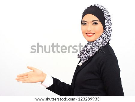 Muslim business woman smile to the camera and ready to handshake, isolated. - stock photo