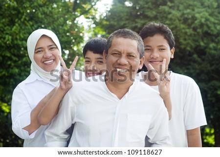muslim family having outdoor fun - stock photo