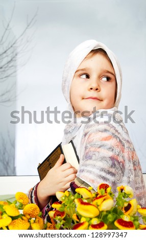 Muslim girl holding Holy Book Qoran - stock photo