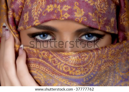 Muslim girl with beautiful blue eyes - stock photo