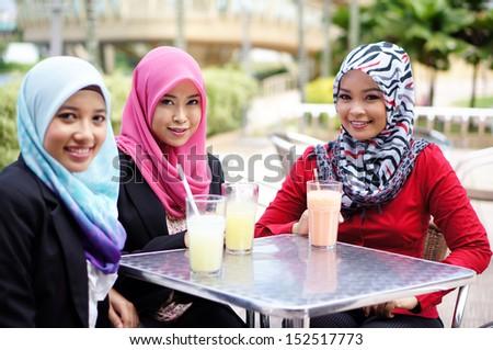 Muslim girls restaurant - stock photo