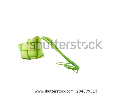 Muslim Ketupat (Rice Dumpling) and Clipping Path. Translation: Eid Mubarak - Blessed Feast Ketupats, a natural rice casing made from young coconut leaves for cooking rice on white background - stock photo