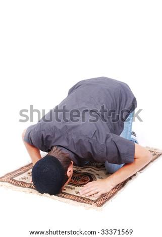 Muslim man is praying on traditional way - stock photo