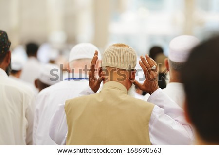 Muslim people in crowd - stock photo