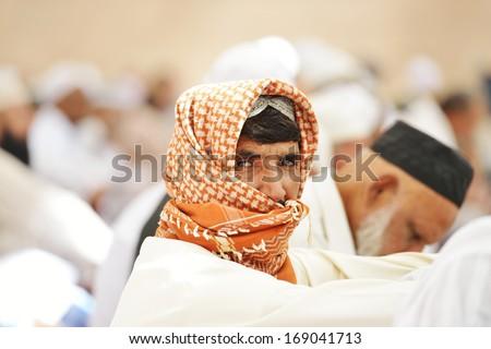 Muslim people in crowd - stock photo