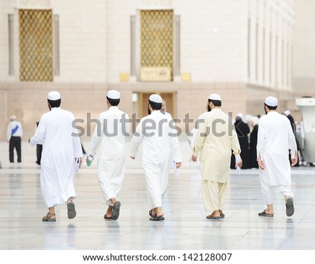Muslim people visiting the holy places - stock photo