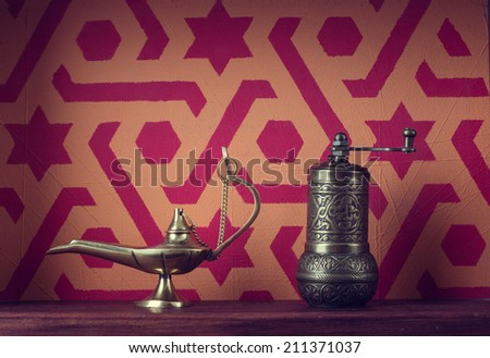 Muslim still life. Lamp and mill - stock photo