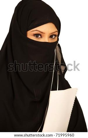 Muslim teenage girl holding books in her hand. - stock photo