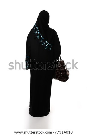 Muslim traditional woman with shopping bag, clothes from back, isolated - stock photo