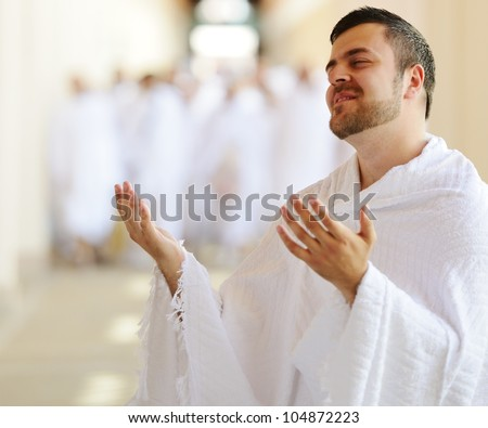Muslim wearing ihram clothes and ready for Hajj at Miqat - stock photo