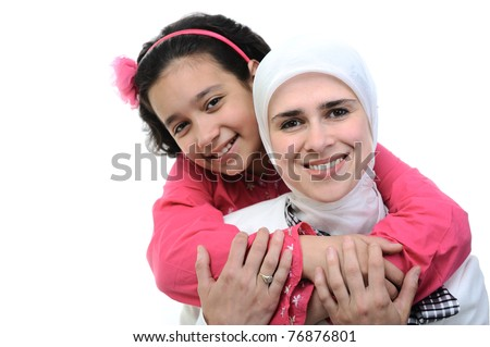 Muslim woman and her daughter is loving - stock photo