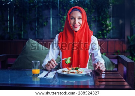 muslim woman enjoying her food after sunset in Ramadan - stock photo