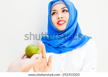 muslim woman fasting on ramadan - stock photo