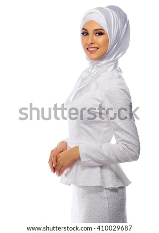 Muslim woman in white dress isolated - stock photo