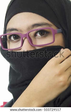 Muslim woman portrait with half closed a face. - stock photo
