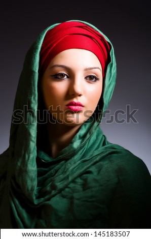 Muslim woman with headscarf in fashion concept - stock photo