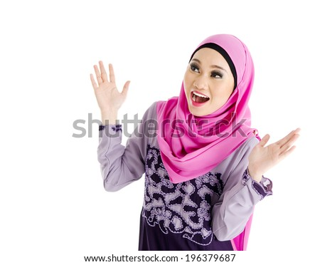 Muslim woman with surprise expression - stock photo