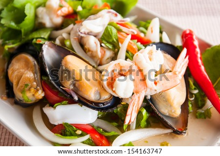 mussel and shrimp mix in yummy asian style - stock photo