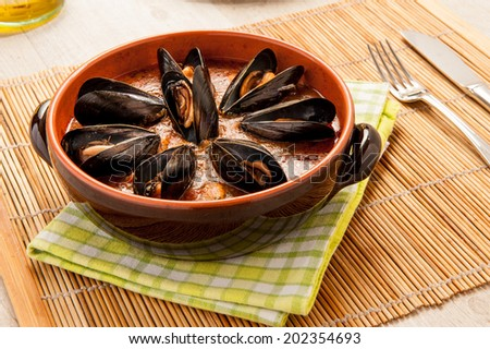 mussel soup with tomato - stock photo