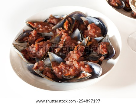 Mussels cooked with tomato sauce - stock photo