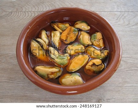 Mussels in typical sauce homemade pickled galician - stock photo