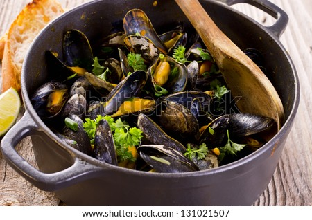mussels stew in white wine - stock photo