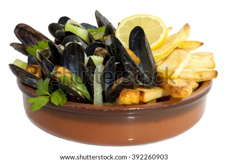 Mussels with herbs and chips isolated over white - stock photo
