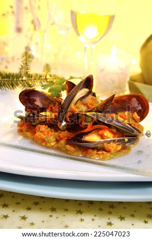 mussels with marinara sauce served as a Christmas meal - stock photo
