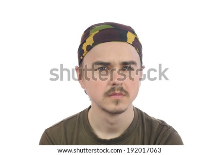 mustachioed young bearded man in a bandana isolated - stock photo