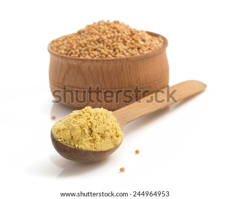 mustard in spoon isolated on white background - stock photo