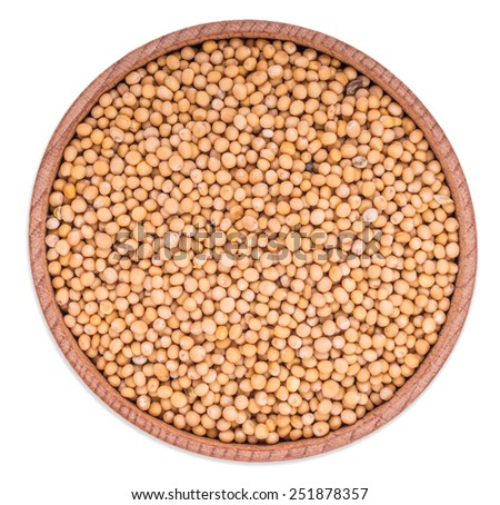 Mustard seeds in wooden bowl, isolated on white background - stock photo