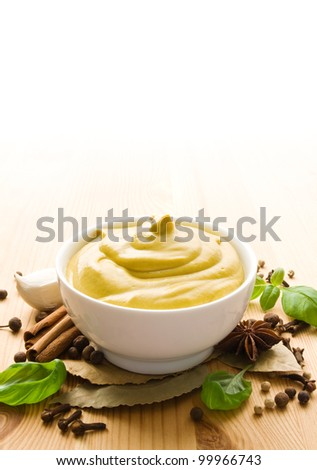 Mustard with herbs and spices - stock photo