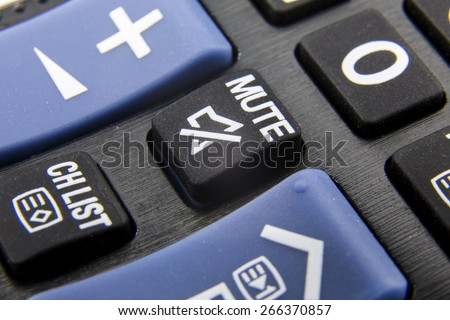 Mute Button on the remote - stock photo