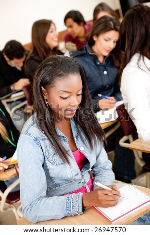 Muti-ethnic group of students in a classroom - stock photo