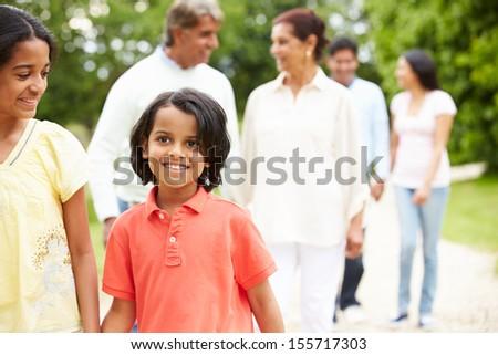 Muti-Generation Indian Family Walking In Countryside - stock photo