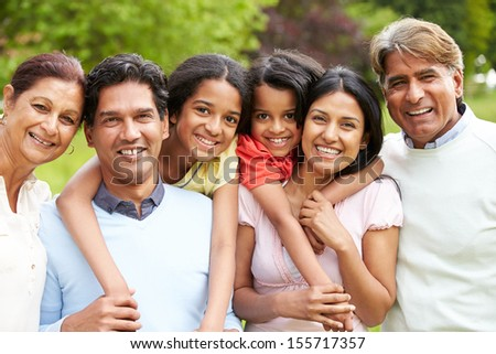 Muti-Generation Indian Family Walking In Countryside - stock photo