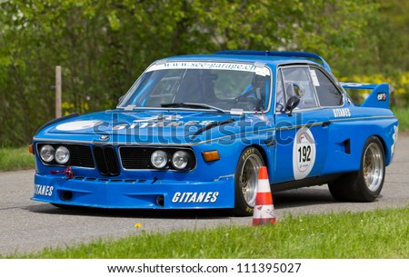 MUTSCHELLEN, SWITZERLAND-APRIL 29: Vintage race touring car BMW CSL 3.5 l from 1973 at Grand Prix in Mutschellen, SUI on April 29, 2012.  Invited were vintage sports cars and motorbikes. - stock photo